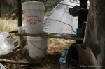 diy grey water filter on left, rocket stove on right